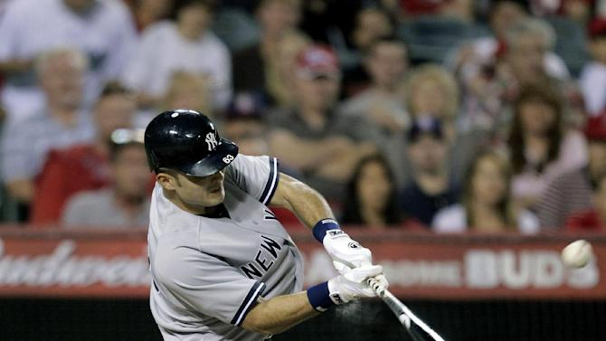 New York Yankees' Jesus Montero hits a home run in the third inning of a baseball game against the Los Angeles Angels, Friday, Sept. 9, 2011, in Anaheim, Calif., Friday, Sept. 9, 2011. (AP Photo/Jae C. Hong)