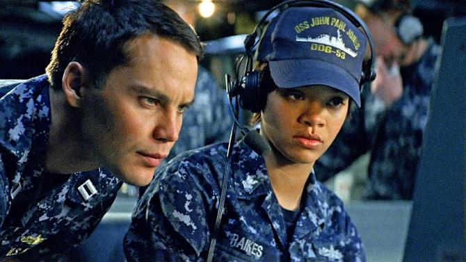 "In this film publicity image released by Universal Pictures, Taylor Kitsch, left, and Rihanna are shown in a scene from ""Battleship."" ""Battleship,"" a Universal Pictures movie based on the Hasbro Inc. board game, has survived an armada of tomato-throwing critics and chugged to $170 million in ticket sales overseas. The haul goes part way to justifying the reported $209-million price tag, but after subtracting splits with theater owners, it is estimated to need about half a billion at box offices to turn a profit. With a fleet of other hotly expected blockbusters surrounding its U.S. release on May 18, the tides need to be solidly in its favor to stay above water. (AP Photo/Universal Pictures)"