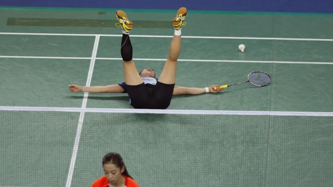 South Korea's Bae reacts after losing a point to China's Wang in their women's team gold medal badminton match during the 17th Asian Games in Incheon