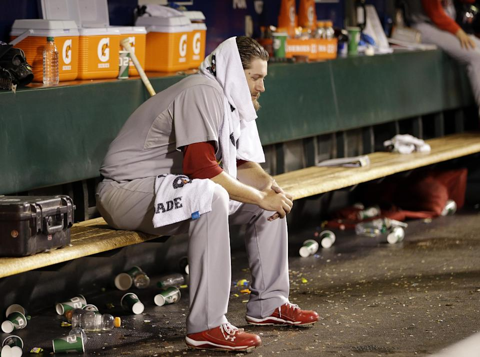 St. Louis Cardinals starting pitcher Lance Lynn sits on the bench after being pulled from the game during the fourth inning of Game 1 of baseball's National League championship series against the San Francisco Giants Sunday, Oct. 14, 2012, in San Francisco. (AP Photo/David J. Phillip)