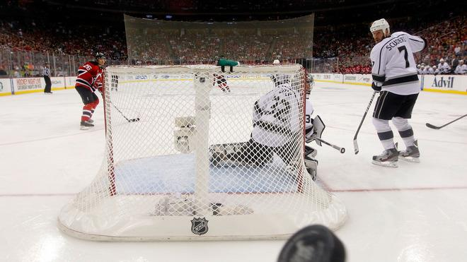 Jonathan Quick #32 And Rob Scuderi #7 Of The Los Angeles Kings Look Back As The Puck Hits The Glass Against The New  Getty Images
