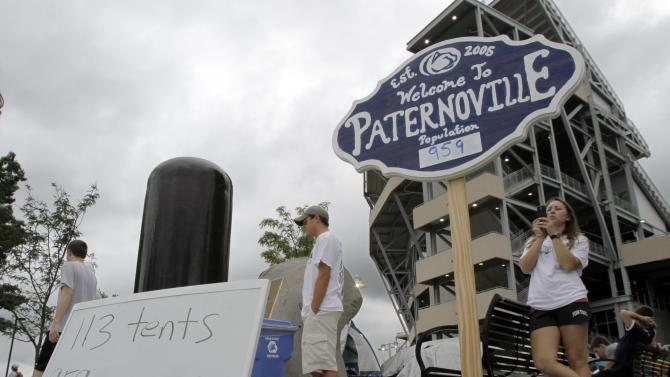 """FILE - In this Sept. 9, 2011, file photo, Penn State students mill around a tent city they call  """"Paternoville,"""" named after the head football coach Joe Paterno, outside Beaver Stadium in State College, Pa. Paternoville is history. It will be replaced by Nittanyville. (AP Photo/Keith Srakocic, File)"""
