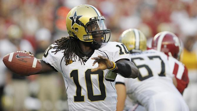 Vanderbilt quarterback Larry Smith (10) looks for a receiver in the first half of an NCAA college football game against Alabama at Bryant-Denny Stadium in Tuscaloosa, Ala., Saturday, Oct. 8, 2011. (AP Photo/Butch Dill)