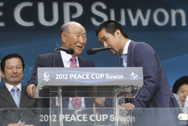 In this July 19, 2012 photo, Rev. Sun Myung Moon, the founder of the Unification Church, left, is escorted by his son, Hyung-jin Moon during the opening ceremony of the 2012 Peace Cup Suwon at Suwon W