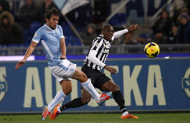 Juventus defender Angelo Ogbonna is challenged by Lazio midfielder Alvaro Gonzalez, of Uruguay, left, during a Serie A soccer match between Lazio and Juventus, at Rome's Olympic stadium, Saturday,
