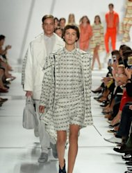 <p>Models walk the runway at the Lacoste Spring 2013 fashion show during Mercedes-Benz Fashion Week at The Theatre, Lincoln Center, on September 8, in New York. The iconic Lacoste brand was founded in 1933 by tennis champion Rene Lacoste, and posted 2011 sales to retailers of 1.6 billion euros.</p>