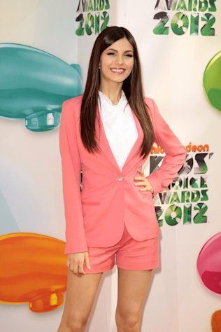 "FILE - This March 31, 2012 file photo shows singer-actress Victoria Justice arriving at Nickelodeon's 25th Annual Kids' Choice Awards in Los Angeles. Justice released a second soundtrack for her hit Nickelodeon series ""Victorious,"" called ""Victorious 2.0."" She co-wrote some of the tracks _ which also features her cast mates _ and said making music for the show is helping her grow as an artist. (AP Photo/Jason Redmond, file)"