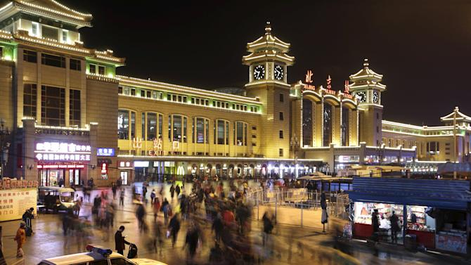 Passengers arrive at Beijing Railway Station for their train rides ahead of the Chinese New Year of the Monkey, in Beijing