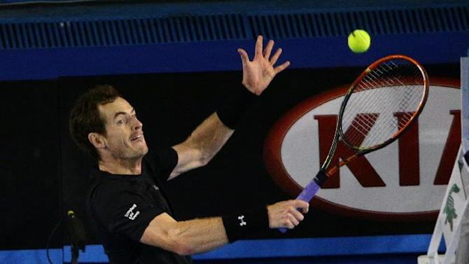 Andy Murray of Britain leaps for a shot to Tomas Berdych of the Czech Republic during their semifinal match at the Australian Open tennis championship in Melbourne, Australia, Thursday, Jan. 29, 2015. (AP Photo/Rob Griffith)