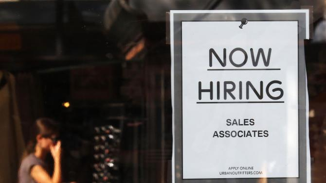 "File photo of ""Now Hiring"" sign at Quincy Market in Boston"