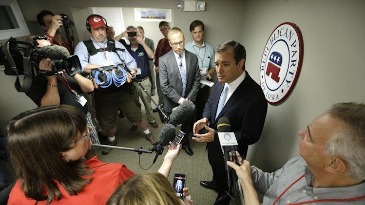 U.S. Sen. Ted Cruz, R-Texas, talks to reporters after speaking at a fundraising picnic for the Iowa Republican Party, Friday, July 19, 2013, in Des Moines, Iowa. (AP Photo/Charlie Neibergall)