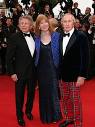 CANNES, FRANCE - MAY 22:  Former Formula 1 driver Sir Jackie Stewart (R), his wife Helen and director Roman Polanski (L) attend 'Weekend Of A Champion' Premiere during the 66th Annual Cannes Film Festival at Palais des Festivals on May 22, 2013 in Cannes, France.  (Photo by Andreas Rentz/Getty Images)