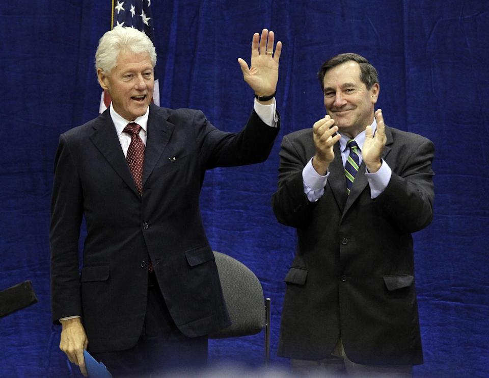 "Indiana Democratic Senate candidate Joe Donnelly, right, applauds as former President Bill Clinton is introduced to speak at ""Hoosier Common Sense"" rally in Indianapolis, Friday, Oct. 12, 2012.  (AP Photo/Michael Conroy)"