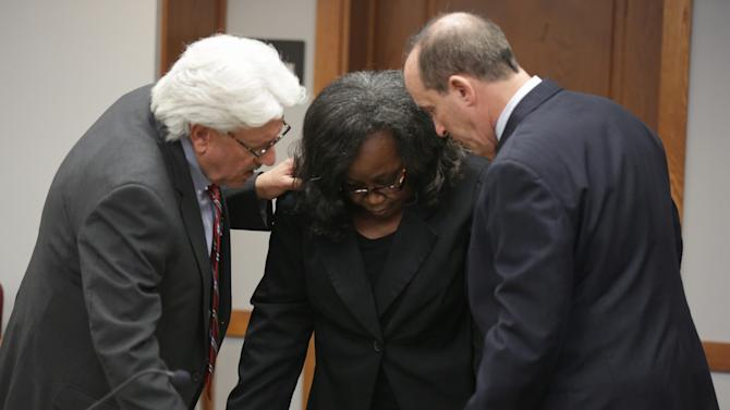 Defense attorney Michael Matters, left, talks to Geralyn Graham, center, in court in Miami, Friday, Jan. 25, 2013, after Graham was convicted of kidnapping and child abuse charges but jurors were unable to agree on a murder charge, leading to a mistrial on that count. Graham was on trial for the murder of Rilya Wilson, a 4-year-old foster child who disappeared while in Graham's care more than a decade ago. (AP Photo/The Miami Herald, Chuck Fadely, Pool)