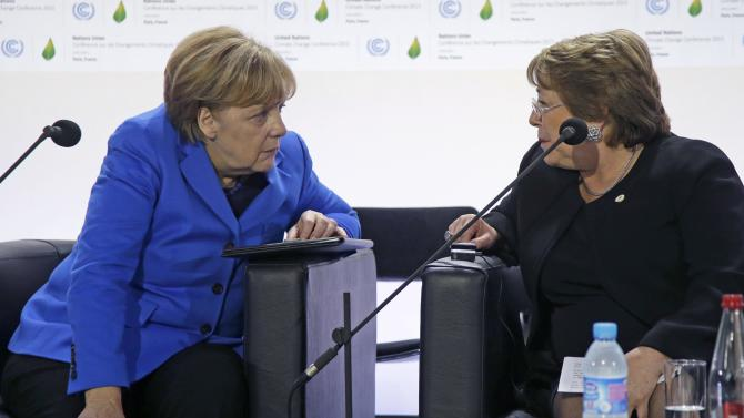 German Chancellor Merkel talks with Chile's President Bachelet as they attend a meeting on Carbon Pricing on the opening day of the World Climate Change Conference 2015 (COP21) at Le Bourget, near Paris
