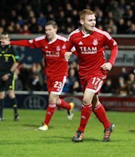 Aberdeen youngster Fraser Fyvie, right, is in talks with Wigan over a possible move south