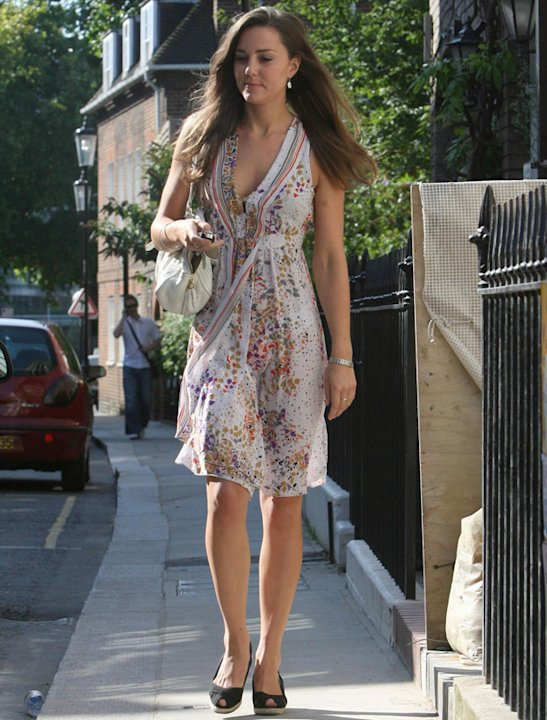 Kate Middleton photos: If there'd been a gust of wind on this summer's day this picture could have had a very different caption… Thankfully the Duchess' modesty remained intact! This floaty frock is j