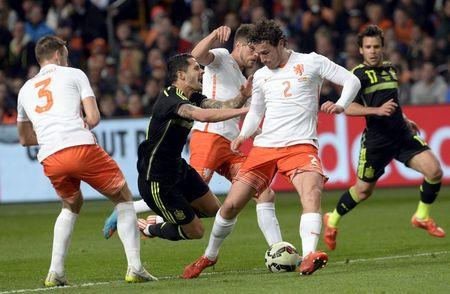 Vitolo of Spain challenges De Vrij and Janmaat of the Netherlands during their international friendly soccer match in the Amsterdam Arena