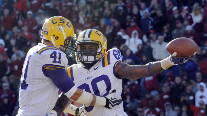 LSU wide receiver Jarvis Landry (80) celebrates his one-handed leaping touchdown catch with teammate tight end Travis Dickson (41) during the second quarter of an NCAA college football game against Arkansas in Fayetteville, Ark., Friday, Nov. 23, 2012. (AP Photo/David Quinn)