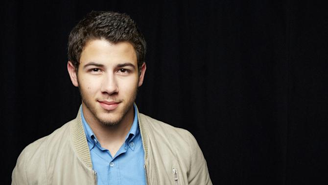 FILE - This April 9 , 2013 file photo shows singer Nick Jonas, posing for a portrait in New York. Jonas will join TV personality Giuliana Rancic as co-hosts for the Miss USA pageant on June 16. (Photo by Dan Hallman/Invision/AP, file)