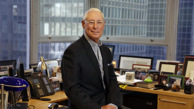 In this Tuesday, July 21, 2015, photo, Henry Schleiff, a group president at Discovery Communications, poses for photos in his office, in New York. As boss of the Investigation Discovery network, Schleiff stays busy hooking viewers on crime. (AP Photo/Richard Drew)