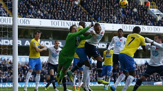 Newcastle United's Tim Krul (3rd L) punches the ball clear from Tottenham Hotspur's Younes Kaboul (5th L) during their Premier League clash at White Hart Lane (Reuters)
