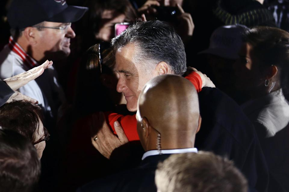 Republican presidential candidate and former Massachusetts Gov. Mitt Romney gets a hug from a supporter campaigns at Ida Lee Park in Leesburg, Va., Wednesday, Oct. 17, 2012. (AP Photo/Charles Dharapak)