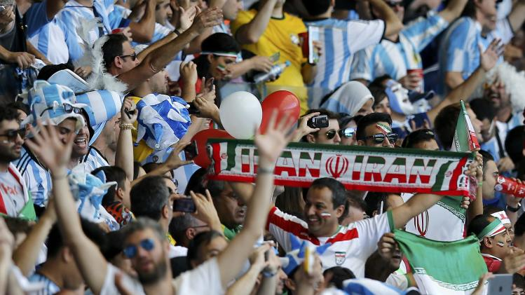 Soccer fans wait for the start of the 2014 World Cup Group F soccer match between Iran and Argentina at the Mineirao stadium in Belo Horizonte