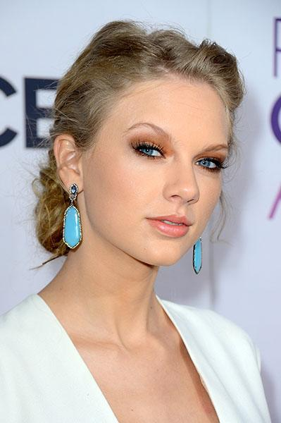 Taylor Swift wearing tantalizing turquoise