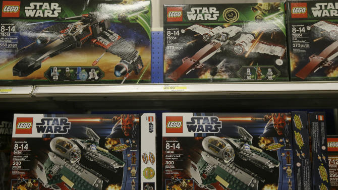 FILE - In this Thursday, Nov. 28, 2013, file photo, Star Wars Lego toys are displayed at a Target Store in Colma, Calif. A Roman Catholic priest has touched off a controversy in Poland after news media quoted him describing toys like LEGO's Monster Fighters as tools of Satan that lead children to the ``dark side.'' The Super Express tabloid quoted the Rev. Slawomir Kostrzewa urging parents to dump the LEGO series as well as Mattel's Monster High and Sanrio's Hello Kitty, the latter promoting pornography. (AP Photo/Jeff Chiu, File)