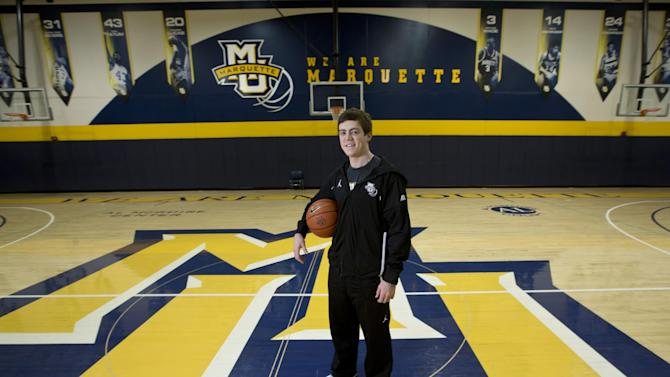 In this photo taken, Dec. 3, 2012, Marquette assistant women's basketball coach Tyler Summitt poses for a picture at the Al McGuire Center in Milwaukee. Summitt has been preparing for this role all of his life. Yes, the lessons he learned watching his mother, Pat, at Tennessee got him ready for his own coaching career. (AP Photo/Morry Gash)