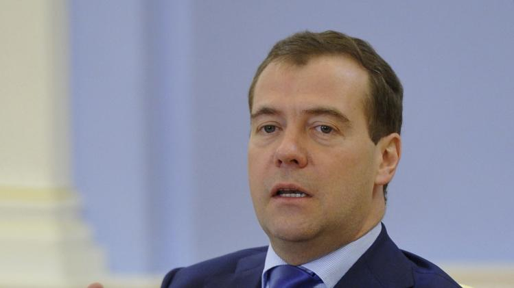 Russian Prime Minister Dmitry Medvedev, right, speaks during his meeting with Russian pupils, in the Gorki residence outside Moscow, Russia, on Friday, Nov. 2, 2012. Medvedev said Friday that he detested the Pussy Riot act, but added the women have been in prison long enough and should be released. (AP Photo/RIA-Novosti, Alexander Astafyev,  Government Press Service)