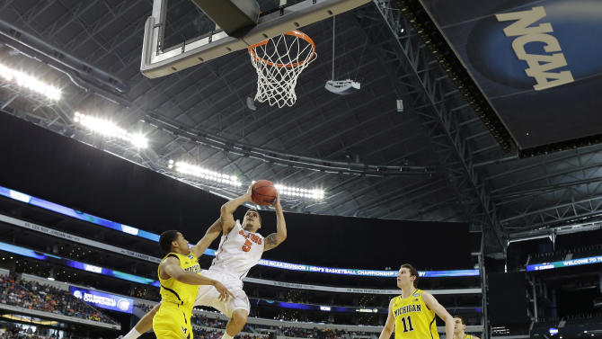 Florida's Mike Rosario (3) shoots against Michigan during the second half of a regional final game in the NCAA college basketball tournament, Sunday, March 31, 2013, in Arlington, Texas. (AP Photo/Tony Gutierrez)