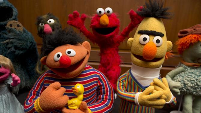 Bert and Ernie, as well as Elmo, center, are among a donation of additional Jim Henson objects to the Smithsonian's National Museum of American History in Washington, Tuesday, Sept. 24, 2013. Miss Piggy joined Kermit the Frog in the Smithsonian Institution's collection of Jim Henson's Muppets, and Bert and Ernie will have a place in history, too. Henson's daughter, Cheryl Henson, is donating 20 more puppets and props to the National Museum of American History. (AP Photo/Jacquelyn Martin)