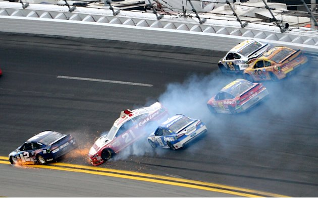 Trevor Bayne (21) spins in Turn 1 as Brad Keselowski (2) hits the apron and Carl Edwards (99), Scott Speed (95), Josh Wise (35) and Austin Dillon (33) try to avoid them during the NASCAR Daytona 500 S