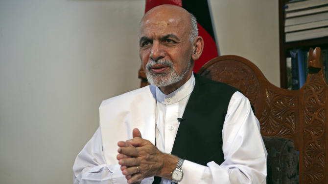 Afghan presidential candidate and former Finance Minister Ashraf Ghani Ahmadzai speaks during an interview with The Associated Press at his residence in Kabul, Afghanistan, Monday, July 14, 2014. Ahmadzai said that a U.S.-brokered deal for a full ballot audit pulled the country back from the brink and put government legitimacy back on track. (AP Photo/Massoud Hossaini)