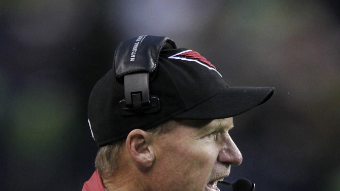 Arizona Cardinals head coach Ken Whisenhunt stands on the sideline during the second half of an NFL football game against the Seattle Seahawks in Seattle, Sunday, Dec. 9, 2012. (AP Photo/Stephen Brashear)