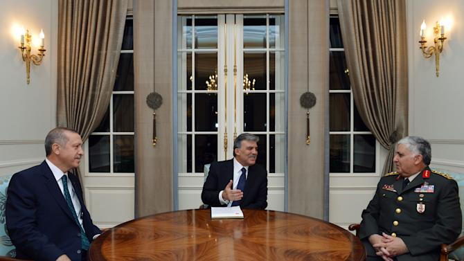 In this photo released by the Turkish Presidency Press Office, Turkish President Abdullah Gul, center, seen during a meeting with Prime Minister Recep Tayyip Erdogan, left, and Chief of Staff Gen. Necdet Ozel in Ankara, Turkey, Monday, Aug. 27, 2012. In 2003, Turkey barred U.S. forces from opening a northern front in the war against Iraq in a stunning rebuff to Washington that raised questions about whether the politically powerful Turkish military had undercut a civilian-led initiative to help the Americans. As Turkey and its allies today mull possible intervention in Syria, the Turkish military, broken as a political force, is likely to move in step with the civilian commanders it once viewed with disdain. (AP Photo/Mehmet Demirci, Turkish Presidency Press Office)