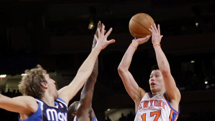 New York Knicks' Jeremy Lin, right, takes a shot over Dallas Mavericks defense during the first half of an NBA basketball game in New York, Sunday, Feb. 19, 2012.  (AP Photo/Seth Wenig)
