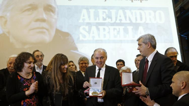 Sabella is applauded during a ceremony in his honour at the Argentine Congress in Buenos Aires