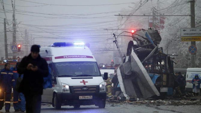 An ambulance leaves the site of a trolleybus explosion in Volgograd, Russia, Monday, Dec. 30, 2013. The explosion left 10 people dead Monday, a day after a suicide bombing that killed at least 17 at the city's main railway. The explosions put the city on edge and highlighted the terrorist threat that Russia is facing as it prepares to host the Winter Games in February. Volgograd is about 650 kilometers (400 miles) northeast of Sochi, where the Olympics are to be held. (AP Photo/Denis Tyrin)