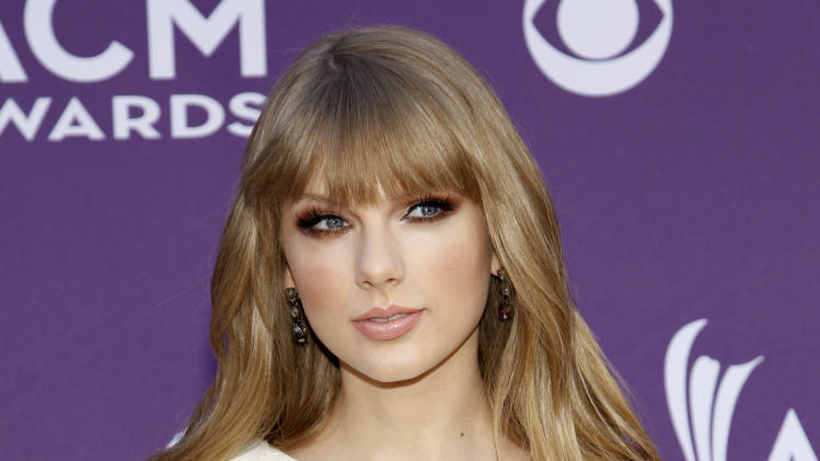 """FILE - This April 1, 2012 file photo shows country singer Taylor Swift at the 47th Annual Academy of Country Music Awards in Las Vegas. Swift's """"The Hunger Games"""" soundtrack entry """"Safe & Sound"""" with The Civil Wars _ a duo happily adopted by Swift's fan base _ also is nominated for video of the year for the 2012 CMT Awards, which kicks off at 8 p.m. EDT Wednesday, June 6, from Nashville's Bridgestone Arena.. (AP Photo/Isaac Brekken)"""