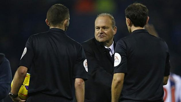 West Bromwich Albion manager Pepe Mel (C) shakes hands with the match officials (Reuters)