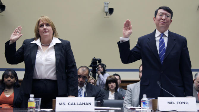 """FILE - In this March 31, 2011, file photo Homeland Security Chief Privacy Officer Mary Ellen Callahan, left, and General Counsel Ivan Fong are sworn in on Capitol Hill prior to testifying about the Freedom of Information Act (FOIA)at a House committee hearing. Acting on his promise to reinvigorate FOIA on his first day in office, Obama told all federal agencies to adopt a """"presumption in favor of disclosure"""". According to an Associated Press analysis of federal data over the last three years from 37 of the largest federal departments and agencies, the Obama administration couldn't keep pace with the increasing number of people asking for copies of government documents, emails, photographs and more under the U.S. Freedom of Information Act.  (AP Photo/Carolyn Kaster, File)"""