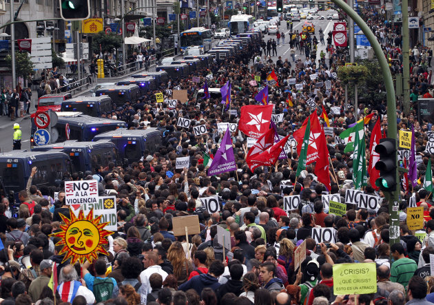 Protestors march to the parliament against austerity measures announced by the Spanish government, in Madrid, Spain, Tuesday, Sept. 25, 2012. Spain&#39;s Parliament has taken on the appearance of a heavily guarded fortress with dozens of police blocking access from every possible angle, hours ahead of a protest against the conservative government&#39;s handling of the economic crisis. The demonstration, organized behind the slogan &#39;Occupy Congress,&#39; is expected to draw thousands of people. It is due to start around 1730 GMT Tuesday. Madrid authorities said some 1,300 police would be deployed. The protestors call for Parliament to be dissolved and fresh elections held, claiming the government&#39;s austerity measures show the ruling Popular Party misled voters to get elected last November. (AP Photo/Andres Kudacki)