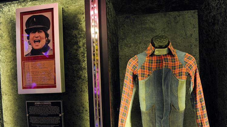 "IMAGE DISTRIBUTED FOR HARD ROCK INTERNATIONAL - A jacket worn by John Lennon and his lyrics to the song ""Help"" are displayed at the launch of Hard Rock International's traveling music memorabilia collection, ""Gone Too Soon,"" Wednesday, Feb. 13, 2013, at Hard Rock Cafe New York.   ""Gone Too Soon"" pays tribute to music icons whose lives and career where tragically cut short and will be on tour at Hard Rock locations in the U.S. throughout 2013. (Photo by Diane Bondareff/Invision for Hard Rock International/AP Images)"