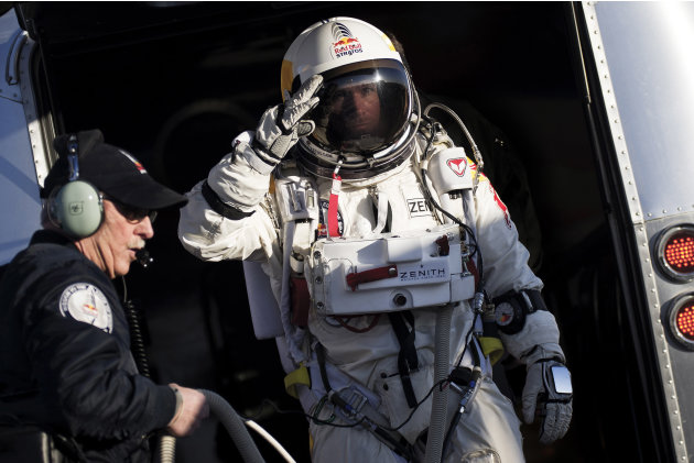 In this photo provided by Red Bull Stratos, Felix Baumgartner salutes as he prepares to board the capsule carried by a balloon during the first manned test flight for Red Bull Stratos in Roswell, N.M.