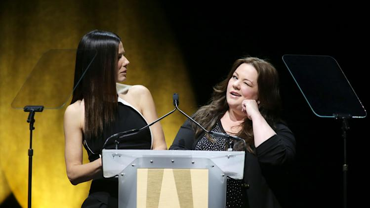 "Sandra Bullock and Melissa McCarthy, cast members in the upcoming film ""The Heat"" at the 20th Century Fox Presentation at 2013 CinemaCon, on Thursday, April, 18th, 2013 in Las Vegas. (Photo by Eric Charbonneau/Invision for 20th Century Fox/AP Images)"
