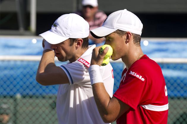 Canadian tennis player Daniel Nestor (L) and Vasek Pospisil (R) prepar a strategy against Israeli tennis team players Jonathan Erlich and Andy Ram of Israel tennis team during their Davis Cup world gr