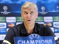 Arsenal's head coach Arsene Wenger gives a press conference in Montpellier, France. Wenger has warned his Arsenal players not to pay too much attention to Montpellier's domestic problems ahead of their Champions League opener on Tuesday